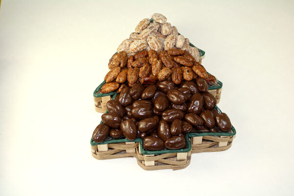 Various nuts in christmas tree shaped tin