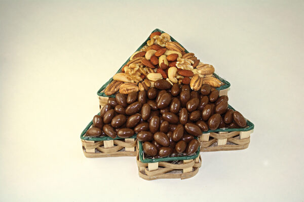 Nuts in christmas tree shaped tin