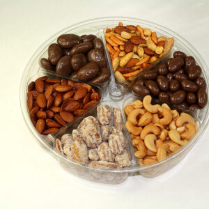 Nut candy tray with almonds, pecans, cashews, and chocolate covered nuts