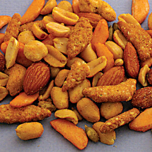 Cajun mix consisting of roasted and salted almonds, VA-P nuts, chili bits, pumpkin seeds, and sesame sticks in cajun powder